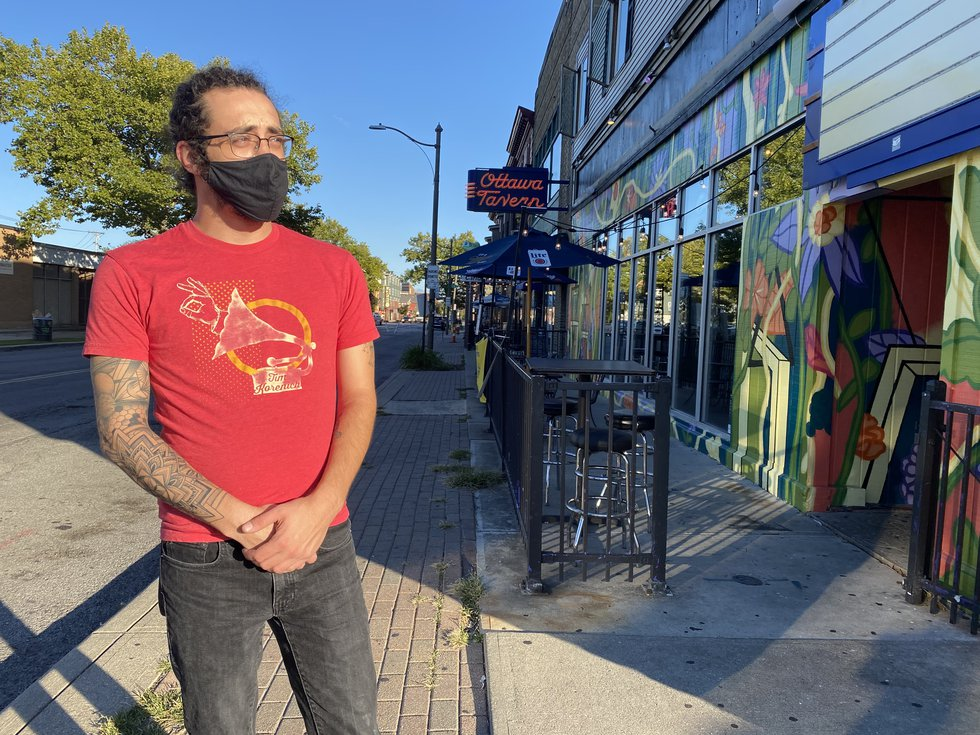 The owner of the Ottawa Tavern, Zack Jacob's stands in front of its empty patio, pleading for...