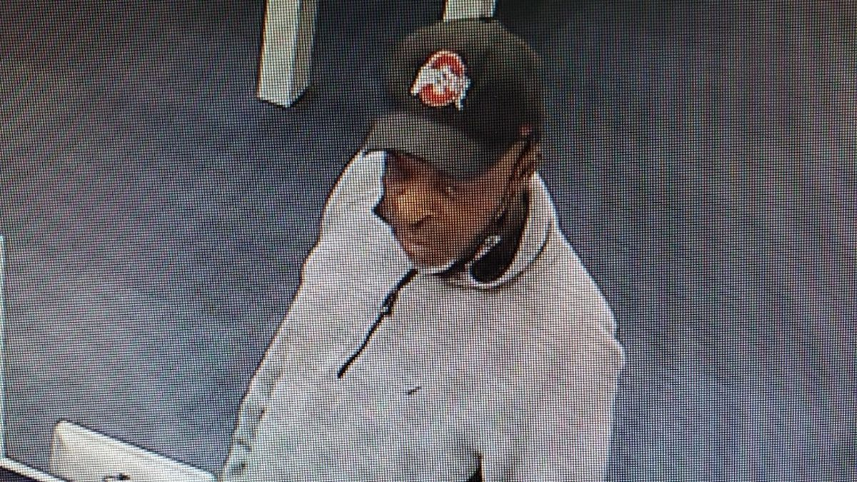 Toledo Police have released this image of a suspect who allegedly used a stolen credit card to...