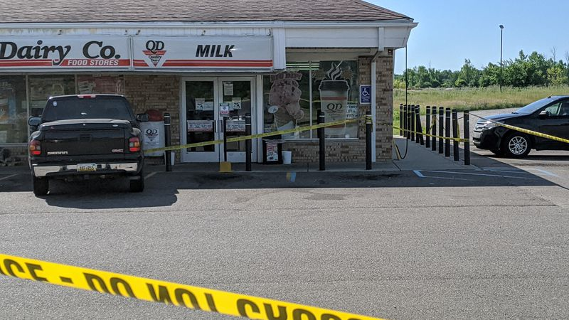 Police have taped off the Quality Dairy located at 7120 Lansing Road in Dimondale.