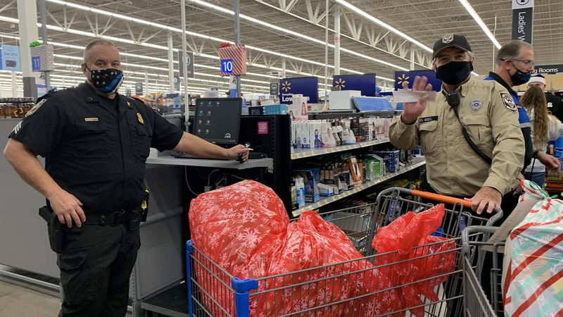 Officers FaceTimed with kids in need and browsed the toy aisles of Walmart to pick out...