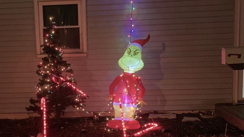 Grinch steals Christmas decoratio