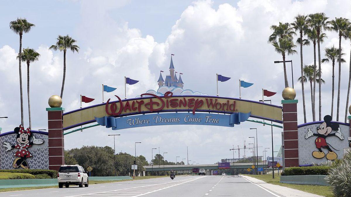 Cars drive under a sign greeting visitors near the entrance to Walt Disney World, Thursday, July 2, 2020, in Lake Buena Vista, Fla. (Source: AP Photo/John Raoux)