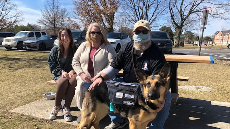 Molly is a service dog that is helping Robert Conner cope with PTSD