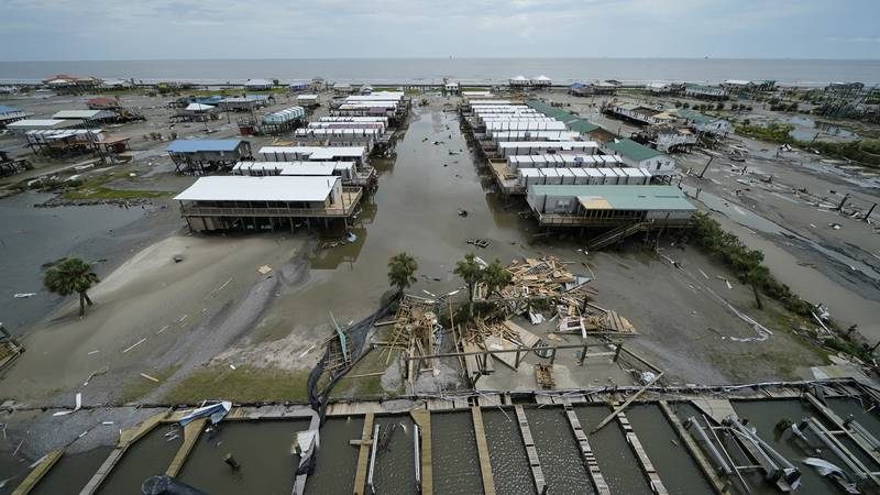In this aerial photo from a rescue flight provided by MedicCorps.org, destruction in Grand...