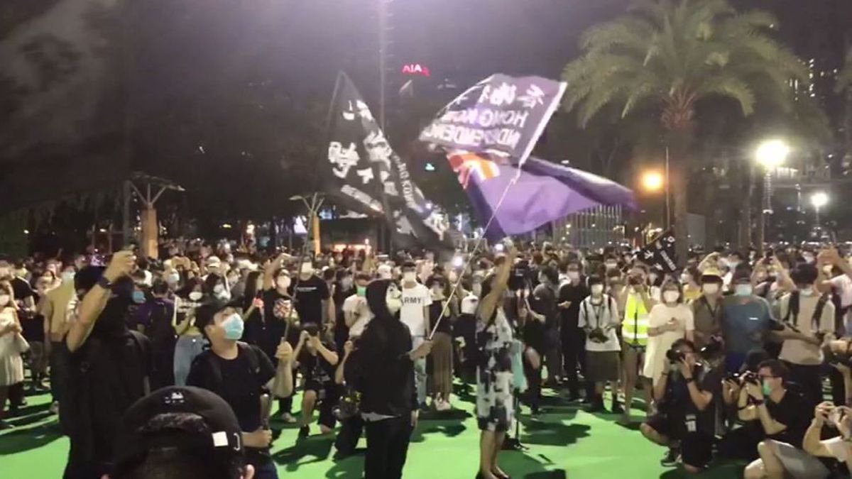 Demonstrators in Hong Kong wave pro-independence flags at a protest about the cancelling of a...