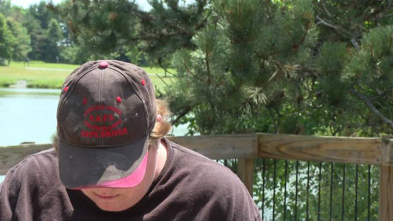 Larcom shows her safe trucker hat as she reminisces over times before her injury.
