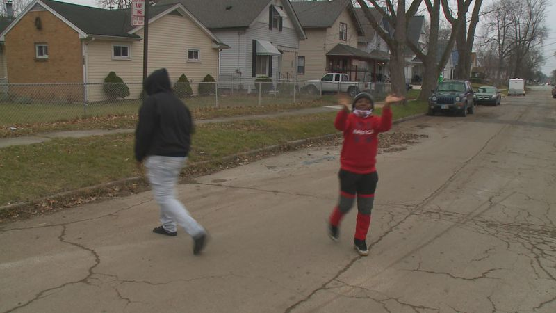 TPD Officers play basketball with local kids