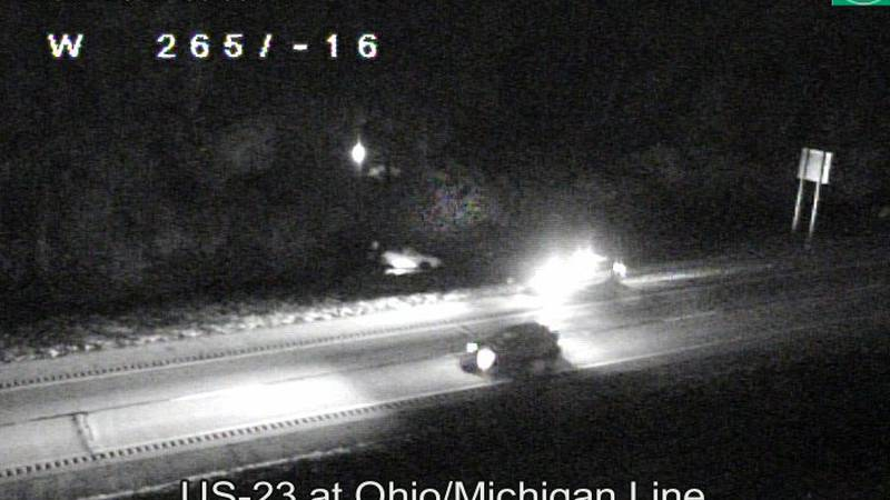A car rests in the grassy area off the right side of US 23 just south of the Ohio/Michigan...