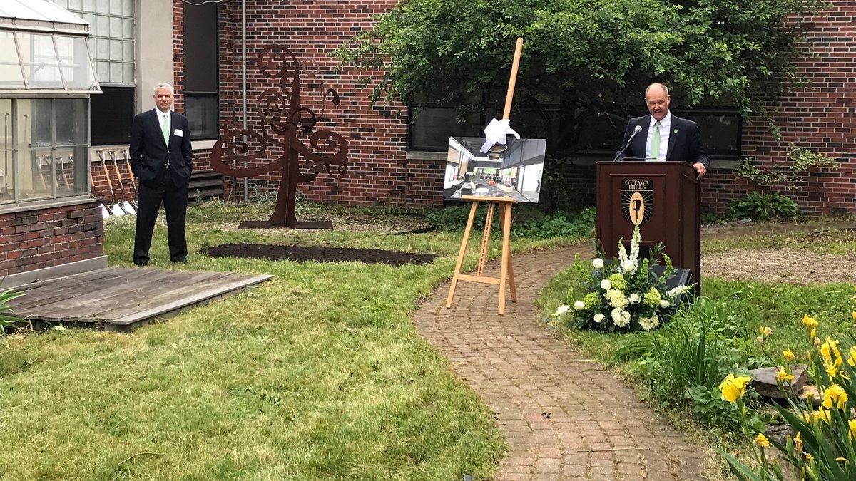 Ottawa Hills superintendent Dr. Adam Fineske, right, speaks during a groundbreaking for new...