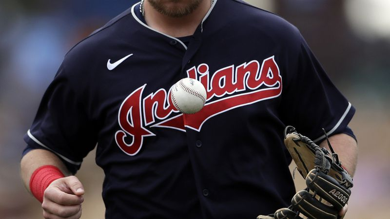 Cleveland Indians second baseman Christian Arroyo tosses a ball coming off the field during the...